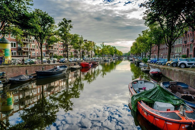 Sail through the canals of the main capital of The Netherlands