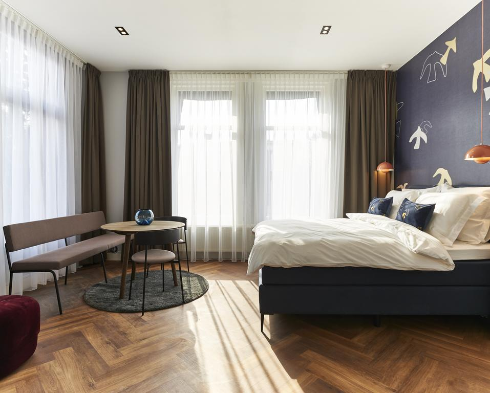 De slaapkamer van Hotel Pistache, een van de leukste boutique hotels van Den Haag